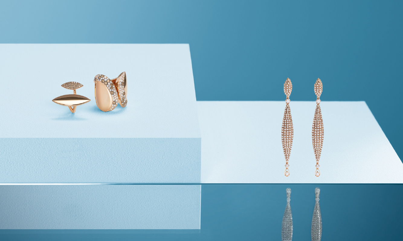 Pink gold rings and earrings with a brown and white brilliants. | Crivelli Official