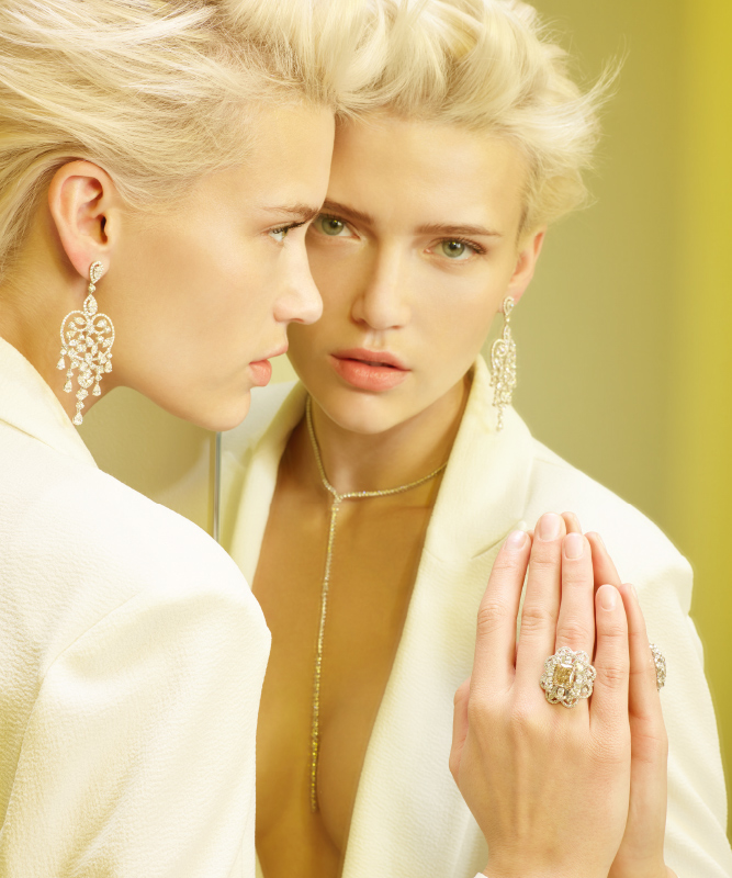 White gold earrings and necklace with brilliants. Ring made of white gold, with brilliants and a yellow diamond. | Crivelli Official