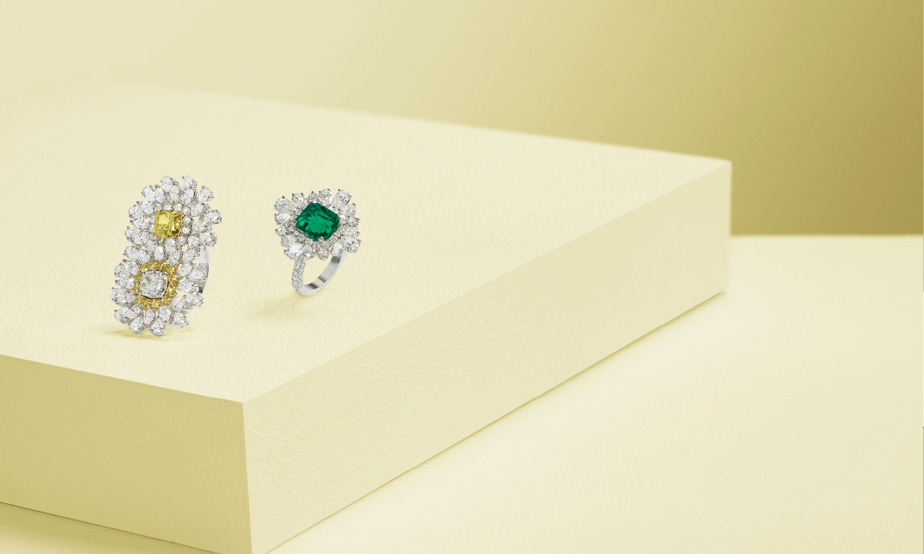 White gold with white and yellow diamonds. White gold ring with white brilliants and a emerald. | Crivelli Official