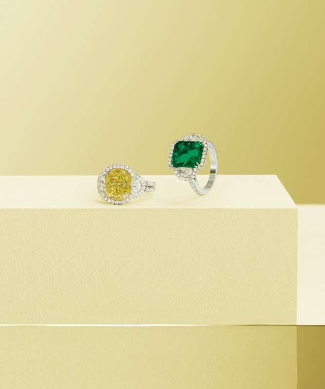 White gold ring with brilliants and yellow diamond. White gold ring with brilliants and emerald.| Crivelli Official